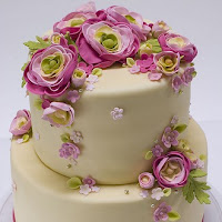 ranunculus flowers on wedding cake