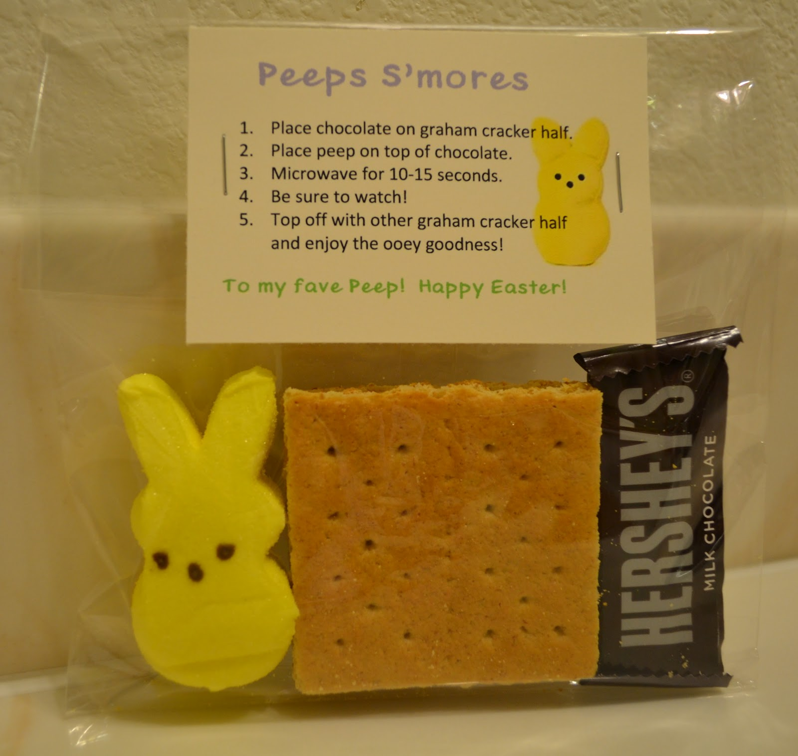 placed all the necessary ingredients to make Peep S'mores in the ...