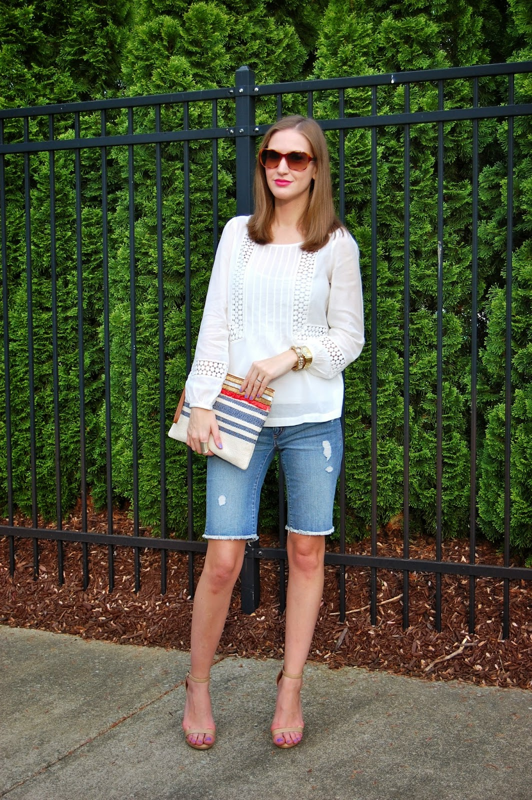 Wearing Loft crochet peasant blouse, distressed denim walking shorts, Loft oversized clutch pouch, Michael Antonio Lovina ankle strap heels