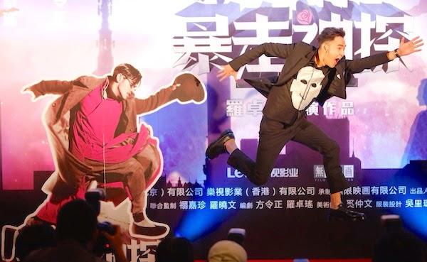 Ethan Ruan Jing Tian wears Lanvin Fall Winter 2014 horror mask black shirt at Shanghai Noir press conference November 2014 Macau 11月3日,电影《暴走神探》在澳门举办新闻发布会,主演阮经天、周冬雨、杨子姗亮相现场。
