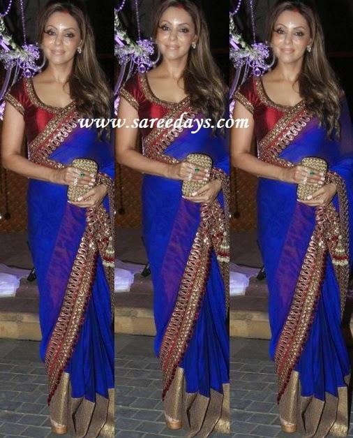 Latest saree designs gauri khan in blue designer saree checkout shahrukh khan wife gauri khan in blue designer saree with gold border and paired with contrast red mega sleeves designer blouse altavistaventures Image collections