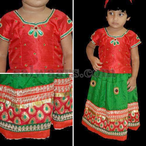 Baby in Green and Red Skirt