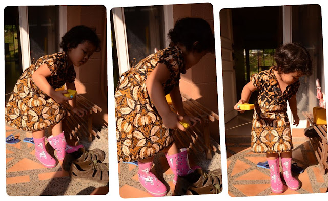 Kecil trying out her new boots