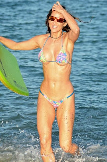 Anais Zanotti wears a blue bikini at the beach in Miami, FL, USA