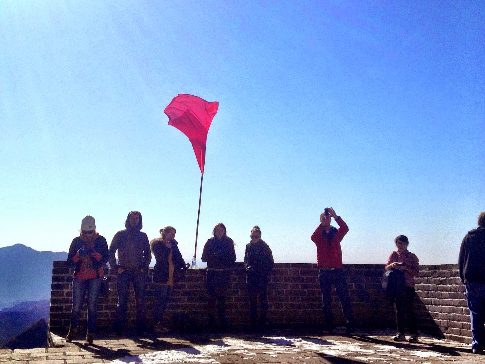 Blue sky and a red flag - group shot on the Great Wall