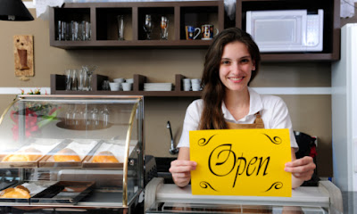A beautiful café owner, small business, entrepreneur, new business, start a new business