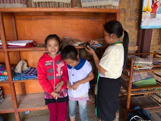 Photo: Girls visit their mother in the Muang La craft shop