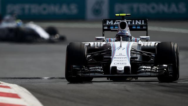 Valtteri Bottas of Finland and Williams drives ahead of Felipe Massa of Brazil and Williams during the Formula One Grand Prix of Mexico on November 1, 2015. (AFP Photo)