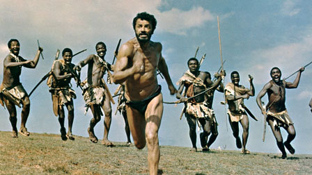 Cornel Wilde as The Man running away from the tribes men who are chasing him down like prey.