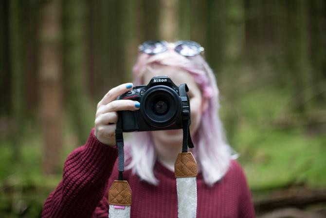 girl holding nikon dslr camera