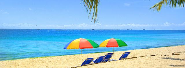 Relaxion Under Umbrella On Beach