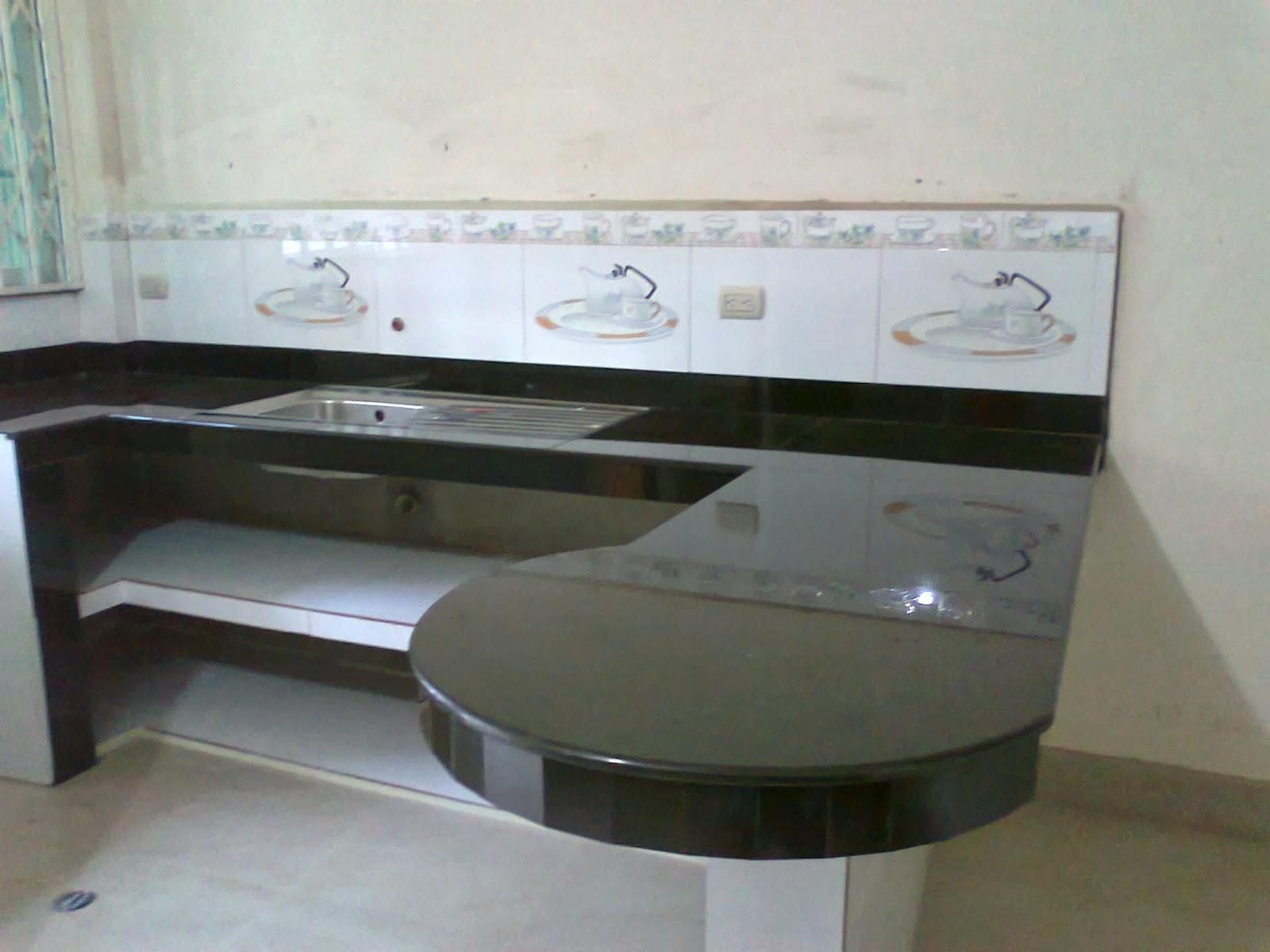 Cocinas enchapadas en porcelanato mesones de cocina for Medidas de mesones para cocina