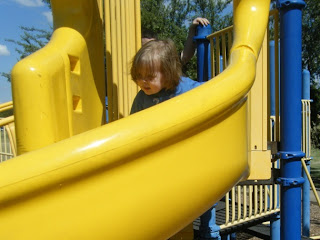 Sasha at top of slide