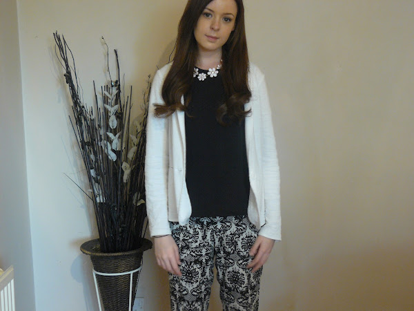 Monochrome printed trousers outfit.