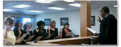 Volunteer court advocates are sworn in before a judge.