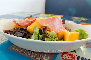 Prosciutto and Cantaloupe Over Dressed Organic Greens