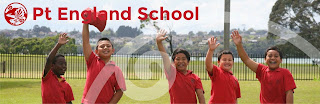 five students waving in red shirts with the Pt.England School logo