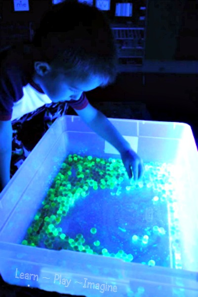 Playing with glowing water beads