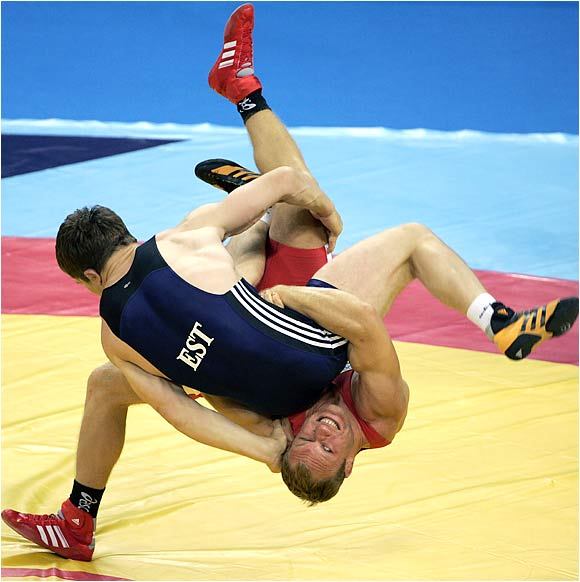 two olympic styles of wrestling Does anyone know what the two different types of wrestling are called there is entertainment wrestling, such as the wwe, and then there is the other wrestling, such as ufc, does anyone know what the second type is called also, do they have different clubs for both types of wrestling.