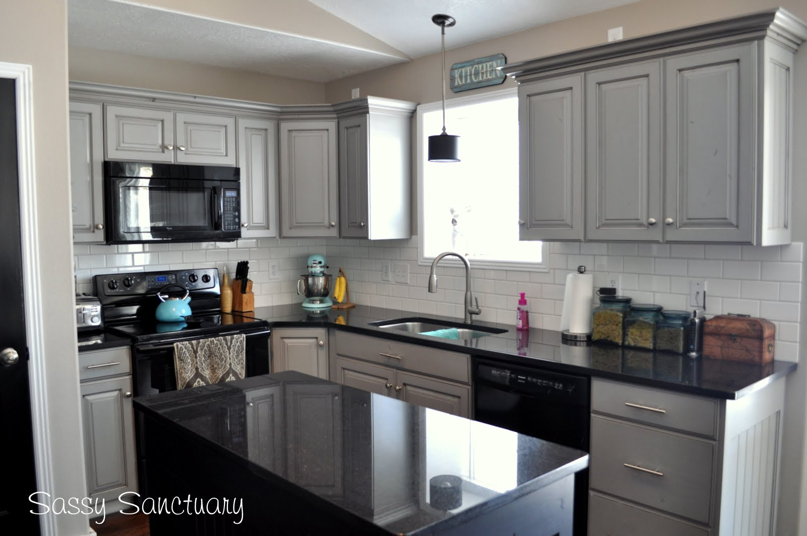 Sassy Sanctuary Kitchen Reveal - Black granite countertops with grey cabinets