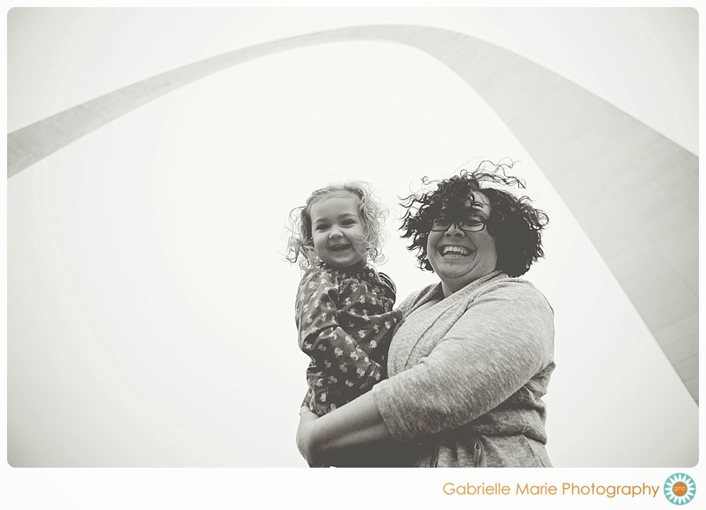 Mom and 3 year old daughter with curly hair smile under the Arch - Best of 2013 Family Photos