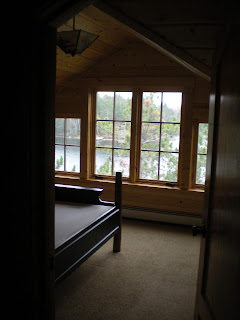 Interior bedroom, view of lake, added dormer by http://huismanconcepts.com/