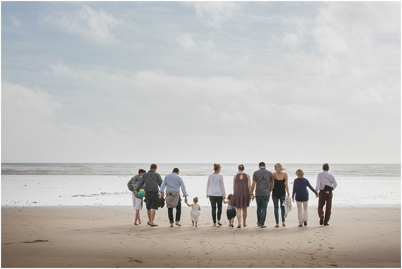 A family walking across the sand together