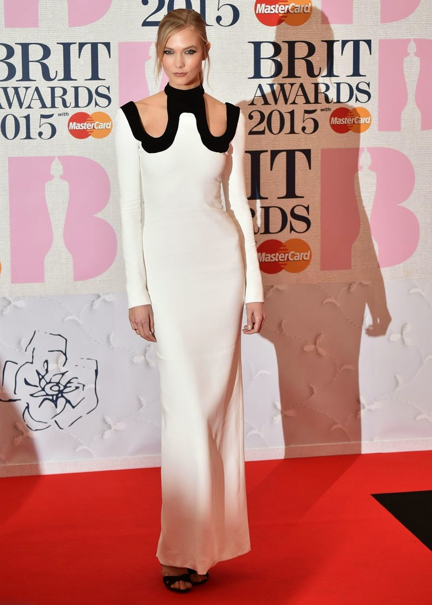 Karlie Kloss in a figure hugging white dress at the 2015 BRIT Awards in London