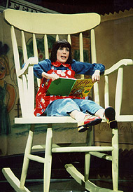 lily tomlin would perform on laugh-in, sitting in a giant rocking