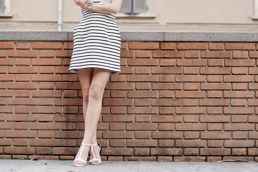 Chic cocktail look featuring a striped raffia dress , white sandals and black accessories. irene buffa outfit of the day