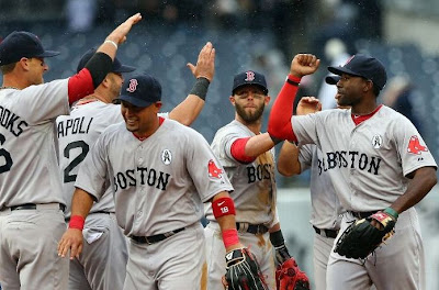 The Red Sox celebrate winning game one against the Yankees