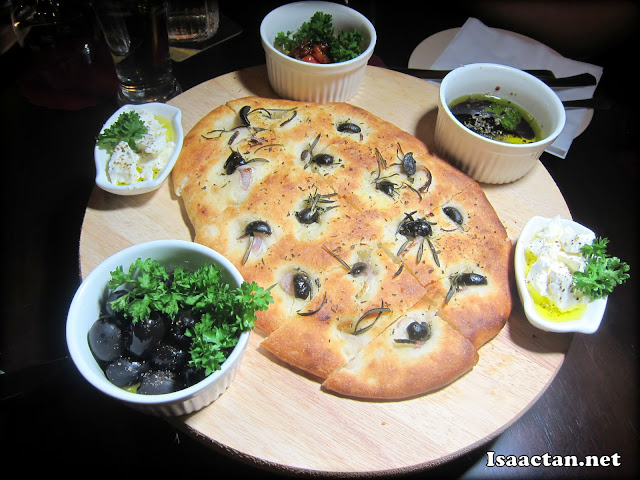 Freshly baked focaccia with 4 sides.