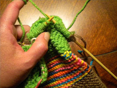 Knit-while-seaming. Your work will be tight at the legs.