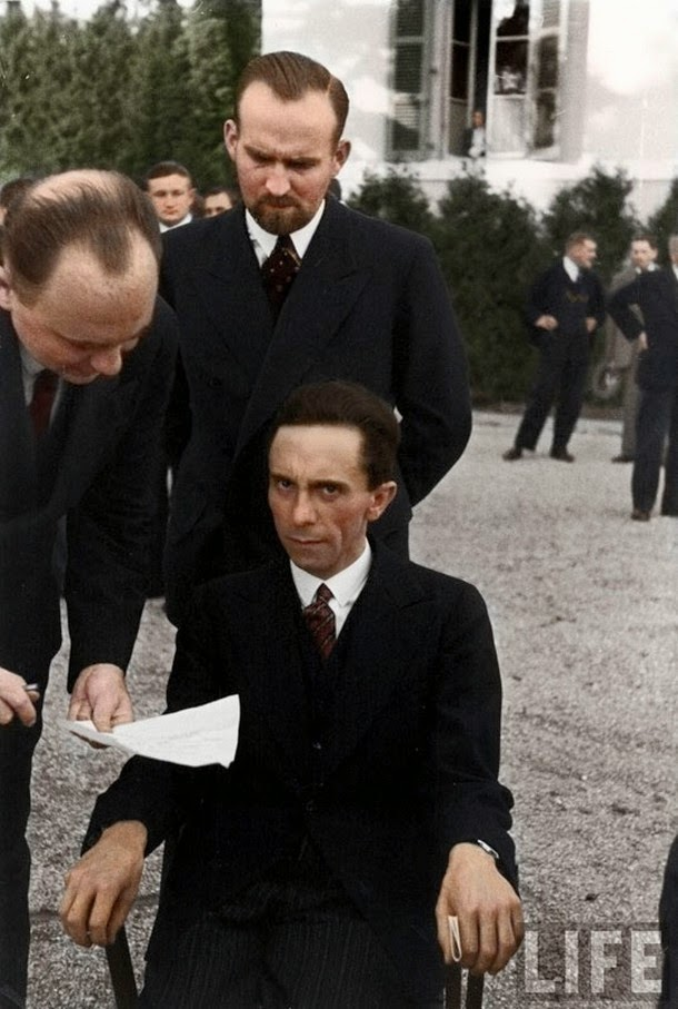 28 Realistically Colorized Historical Photos Make the Past Seem Incredibly Alive - Nazi Minister of Propaganda Joseph Goebbels scowls at a Jewish photographer, 1933