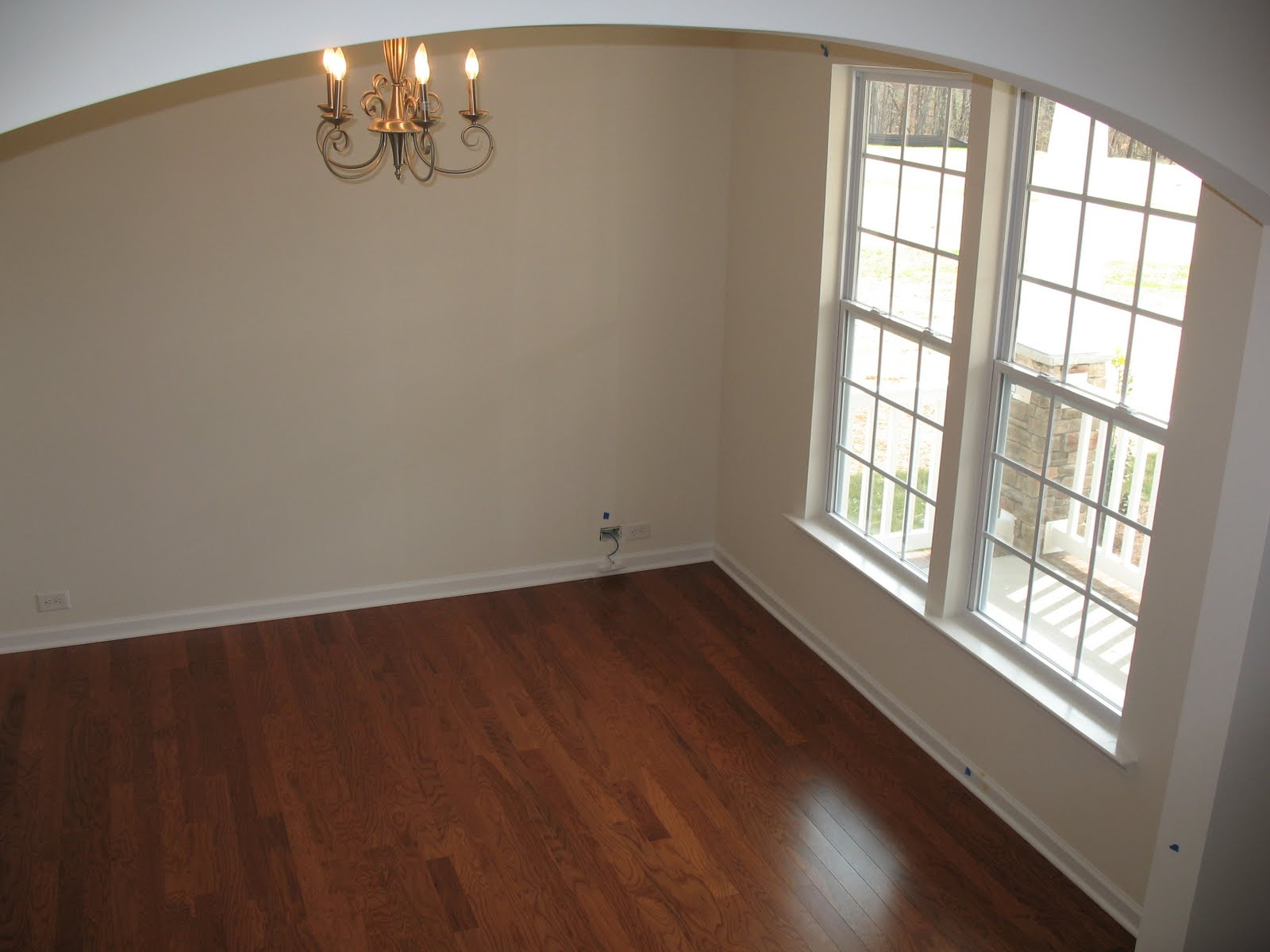 Empty Rooms Separated By Wall