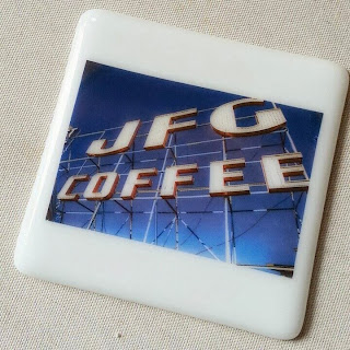 photo of JFG sign in full color fused to a fused glass coaster