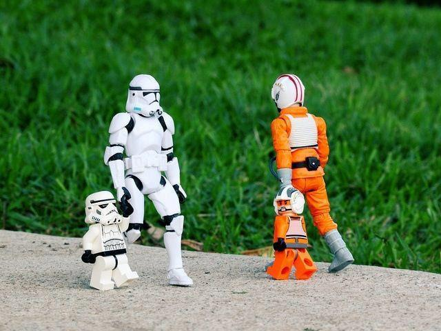 stormtropper and his kid lego doll walking