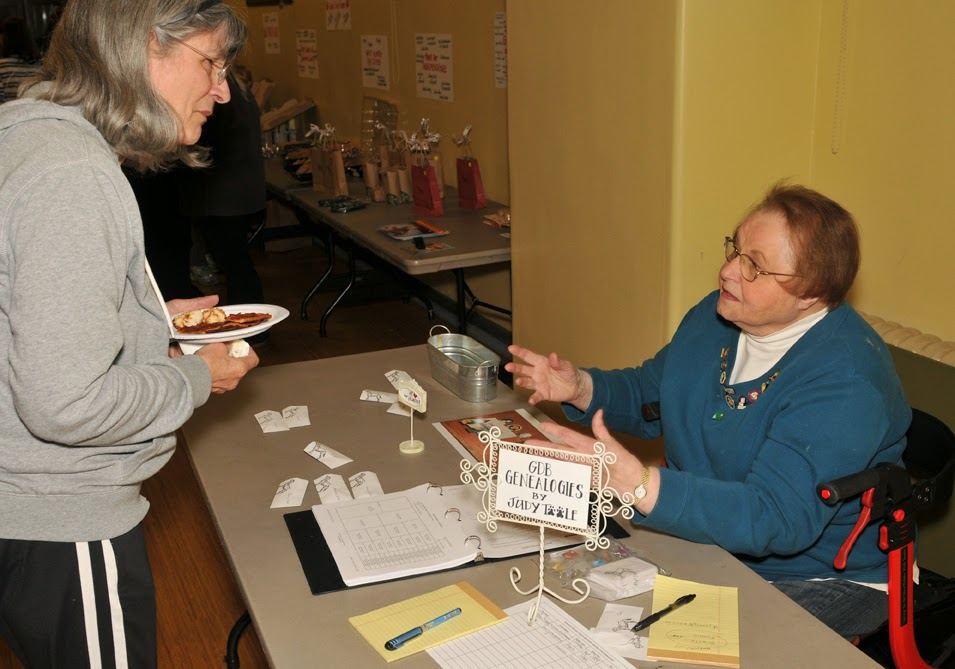 two volunteer have a discussion with several volunteer cards on the table.