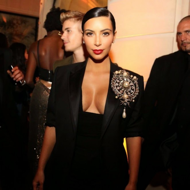 Kim Kardashian flaunts a plunging neckline at the CR Fashion Book #5 Paris Launch Party