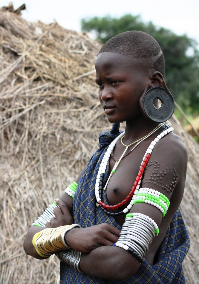 African Tribal Women Mursi - girls with lip plates