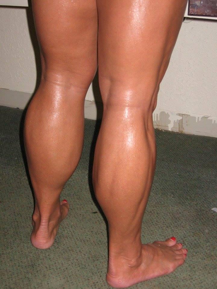 muscular legs oiled on women