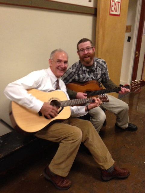 Principal Locke a gets a guitar lesson from music teacher Mr. Gerolami.