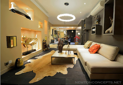 statues and animal rug inside modern living room