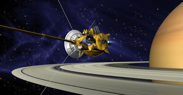 This is an artists concept of Cassini during the Saturn Orbit Insertion (SOI) maneuver, just after the main engine has begun firing. Credit: NASA/JPL