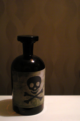 small bottle of poison art