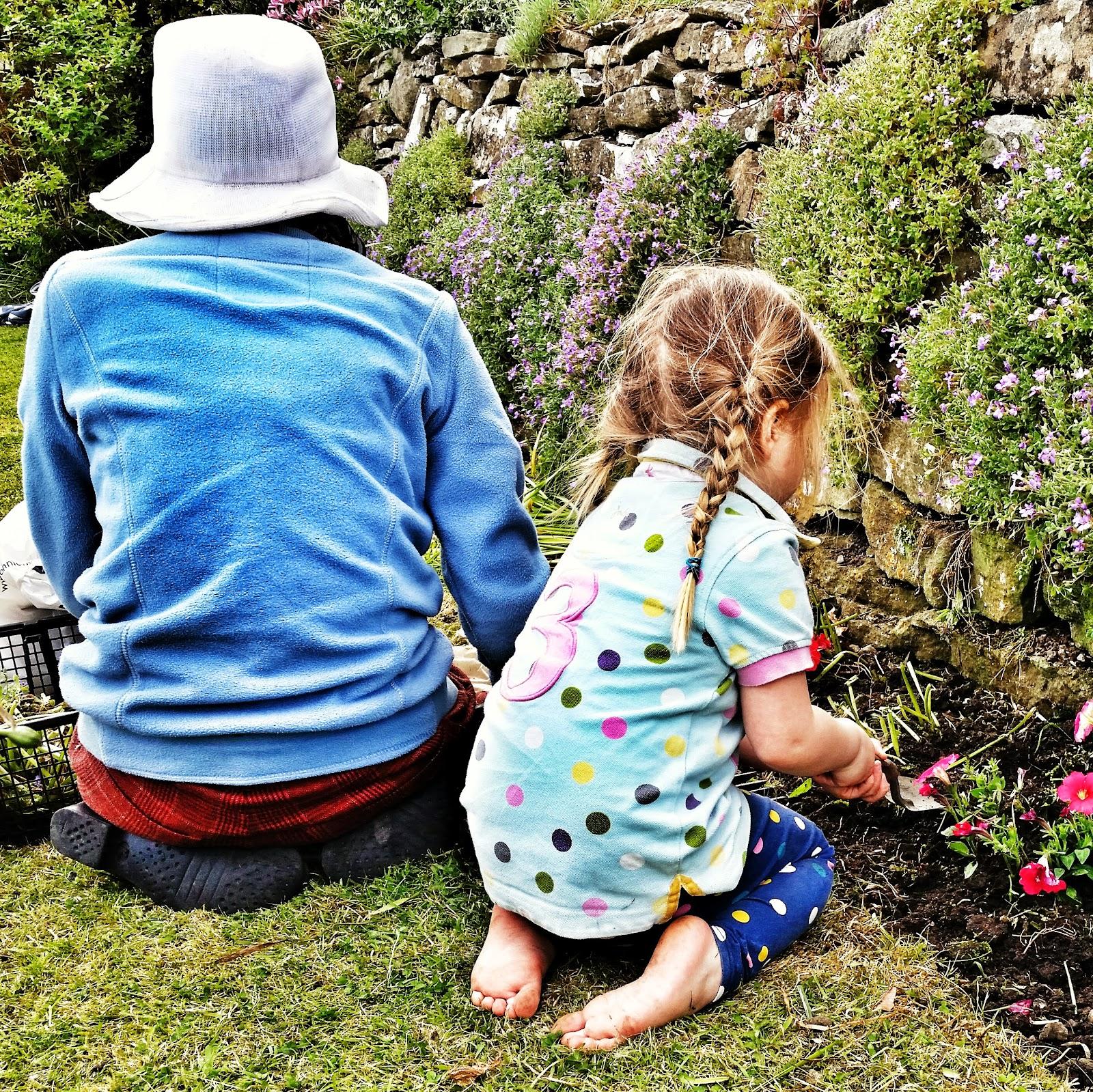 helping great-grandma in the garden