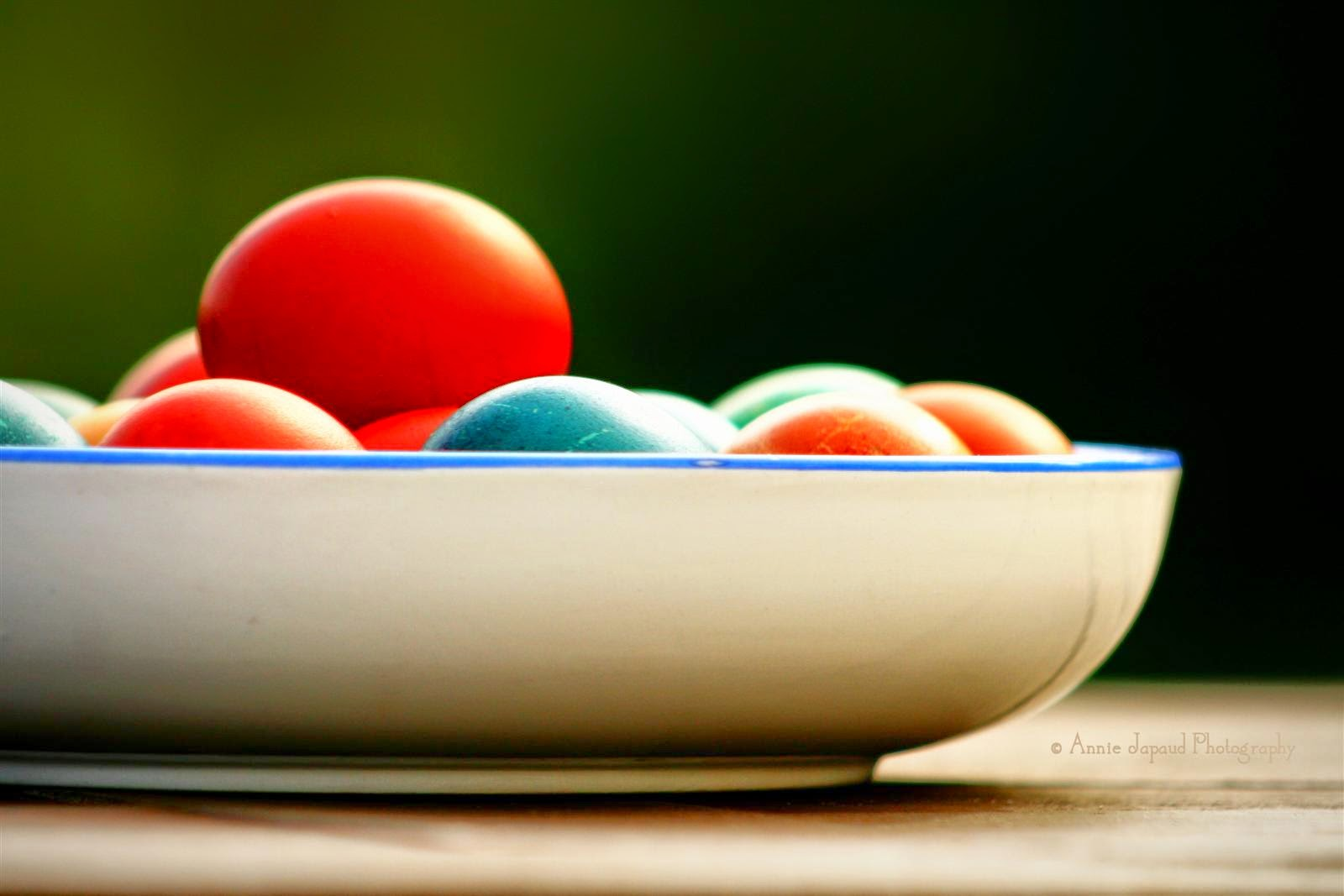 a bowl of coloured Easter eggs