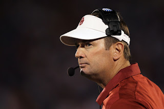 Head coach Bob Stoops of the Oklahoma Sooners watches from the sidelines during the game against the Kansas Jayhawks on October 15, 2011 at Memorial Stadium in Lawrence, Kansas. (October 14, 2011 - Source: Jamie Squire/Getty Images North America) 