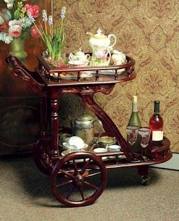http://www.victoriantradingco.com/item/77-kn-7711913/101102104/mrs-crumpets-tea-cart