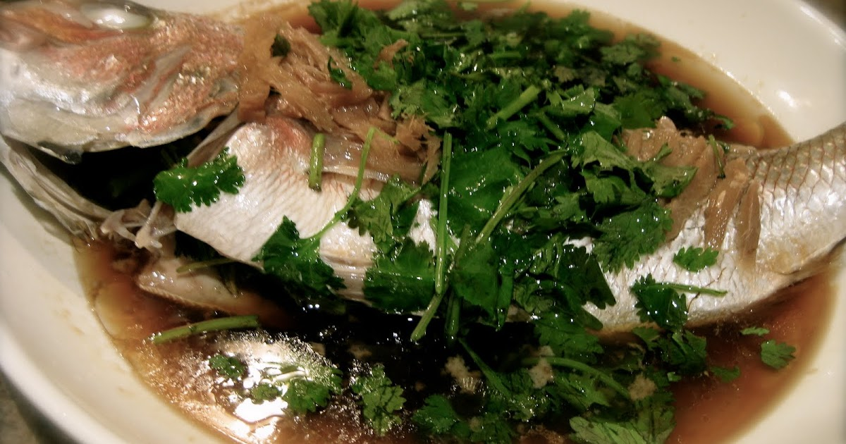 Cook chinese steamed fish with ginger and light soy sauce for Chinese steamed fish